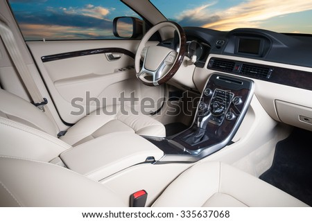 Modern car interior with sunset in the windows - stock photo