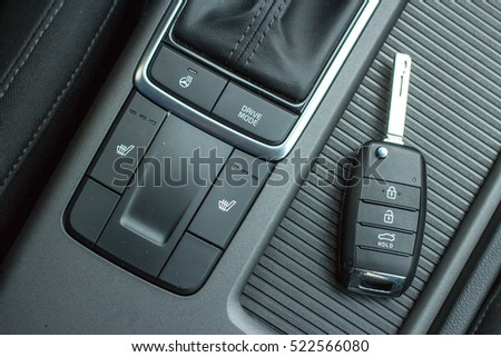 Modern Car remote control key in vehicle interior