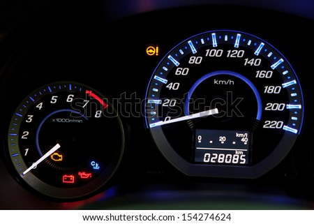 Modern car speedometer  and illuminated dashboard