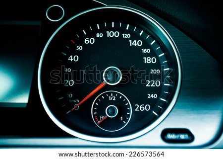 Modern car speedometer. Close up shot of the dashboard a car.