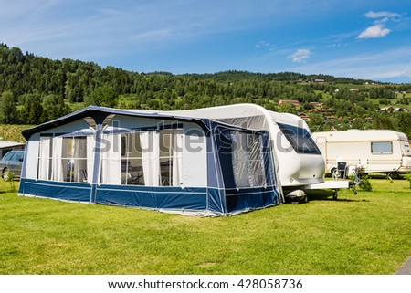 Modern Caravan With Tent At Campsite In Norway On A Sunny Summer Day