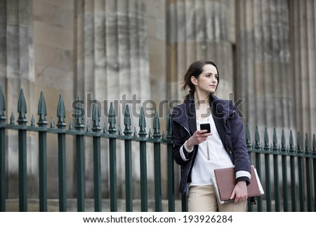 Modern Caucasian Business woman, talking on mobile smart phone outside. Beautiful young professional European businesswoman. Caucasian ethnicity. - stock photo
