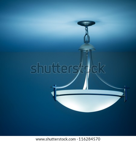 Modern ceiling lamp in a new home - stock photo