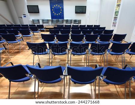 Modern center interior wiith flag of European Union - stock photo