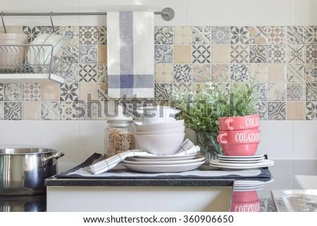 modern ceramic kitchenware and utensils on the black granite counter top - stock photo