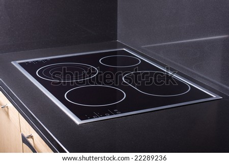 Modern ceramic metal stove in luxurious kitchen - stock photo
