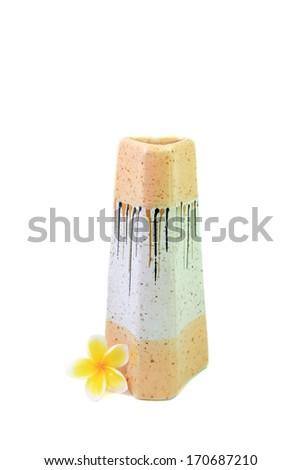 Modern ceramic vase and Plumeria flower in white background. - stock photo