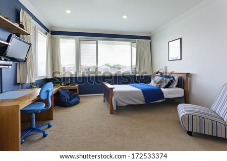 modern child's bedroom with white and blue decor - stock photo