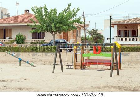 Modern children playground in city park. - stock photo