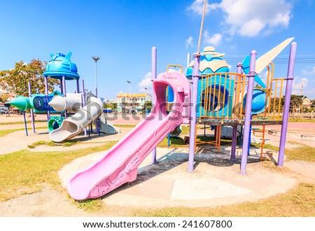 Modern children playground slide in city park - amusement park playground - stock photo