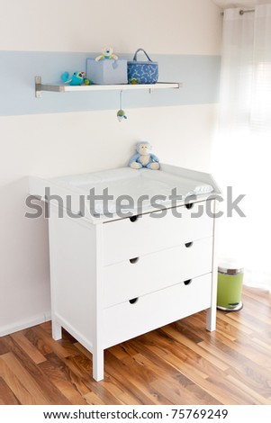 Modern children's playroom with changing table - stock photo