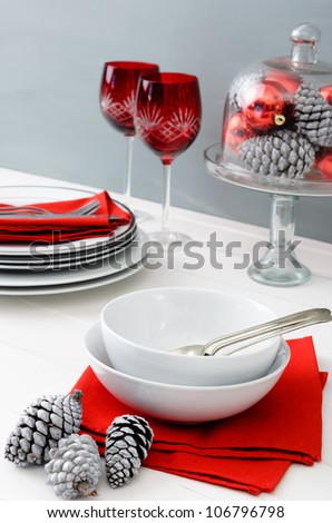 Modern christmas table setting with red accents, minimal, chic and casual - stock photo