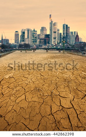 modern city and cracked earth landscape pollution concept