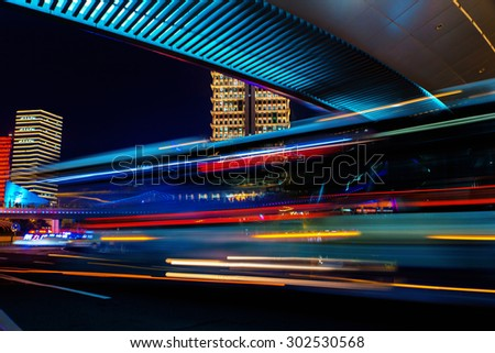Modern city at night. Shanghai Lujiazui finance street. Bus light. - stock photo