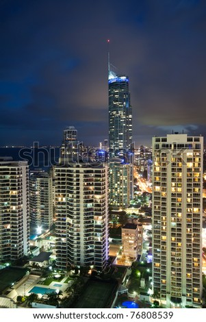 modern city at night viewed from above at vertical format (gold coast, queensland, australia)