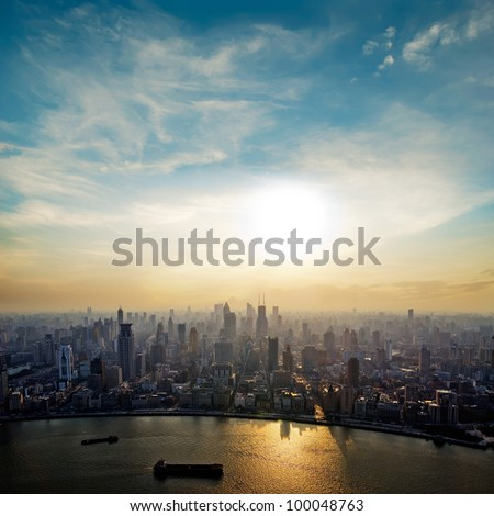 modern city at sunrise,Shanghai skyline.