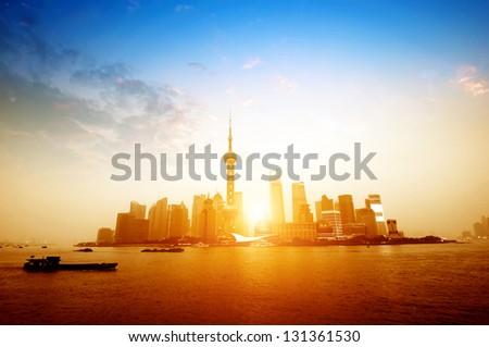 modern city at sunrise,Shanghai skyline. - stock photo