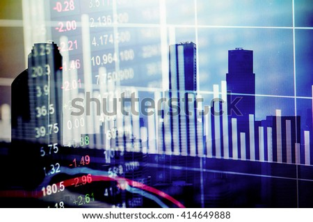 Modern city buildings with a stock exchange board in the background - stock photo