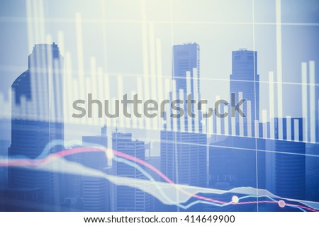 Modern city buildings with a stock exchange board in the background