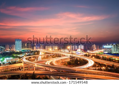modern city interchange in nightfall , beautiful overpass in shanghai  - stock photo