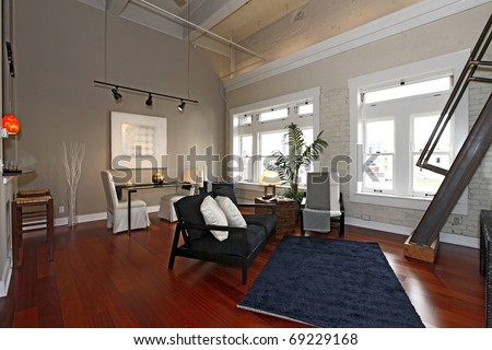 Modern city loft apartment with nice furniture. - stock photo