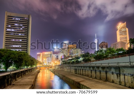 Modern city night scenery with colorful buildings and towers in Kuala Lumpur, Malaysia, Asia. - stock photo