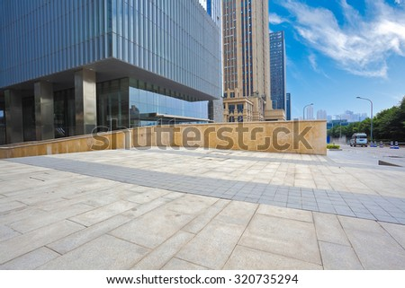 Modern city office buildings background with empty road floor - stock photo