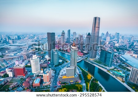 modern city skyline at dusk in tianjin , high angle view