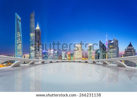 modern city skyline,illuminated skyscraper looking from futuristic office building interior  - stock photo