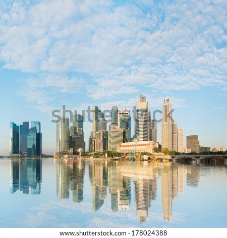 Modern city skyline with skyscrapers buildings under blue sky at morning light, Singapore  - stock photo