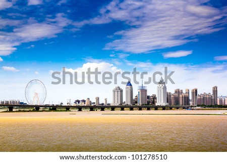 Modern city, skyscrapers, and the water - stock photo