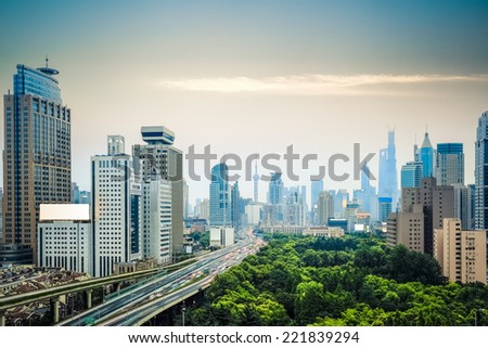 modern city traffic and shanghai skyline , China  - stock photo