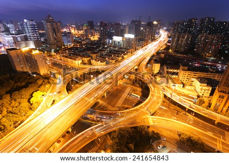modern city traffic and skyline at night,shanghai.