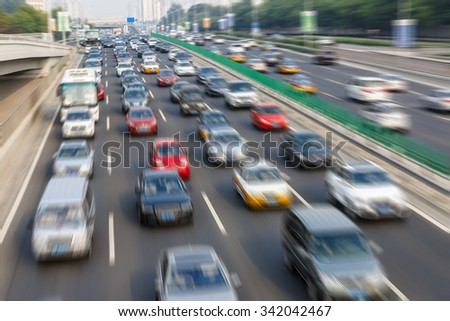 modern city traffic jam in the rush hour??Motion fuzzy automotive background