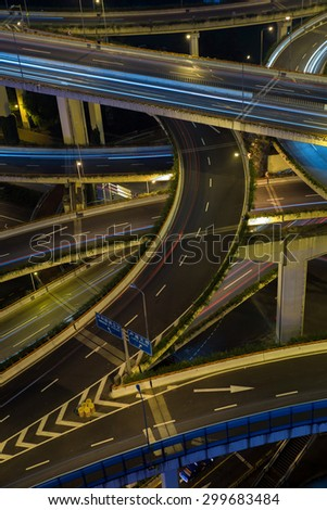 Modern city traffic road at night. Transport road junction. - stock photo