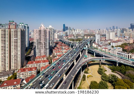 modern city viaduct junction by fisheye view at dusk in shanghai - stock photo