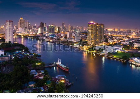 Modern city view of Bangkok city scape at nighttime - stock photo