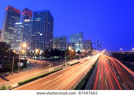 modern cityscape at dusk with traffic in beijing, China