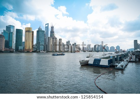 modern cityscape of shanghai skyline with cruise ship terminal - stock photo