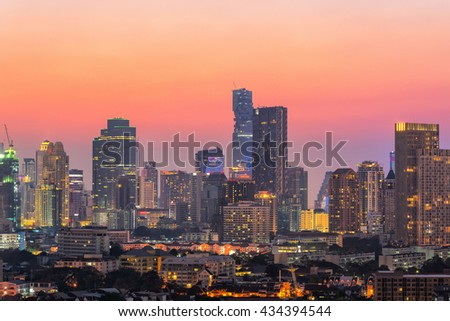 Modern cityscape view of office buildings, condominium in big city downtown at sunset - stock photo
