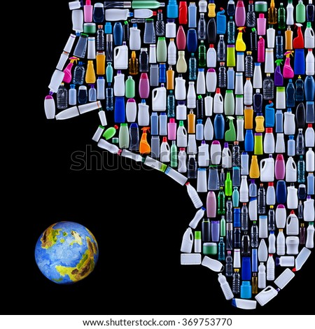 Modern civilization threatening earth - man made of plastic bottles swallows the planet - stock photo