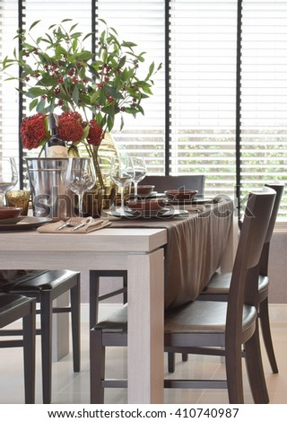Modern classic dining set on wooden table with natural lighting