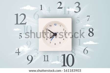 Modern clock with numbers on the side and clouds