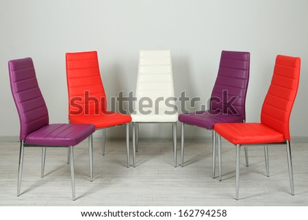 Modern  color chairs on wall background