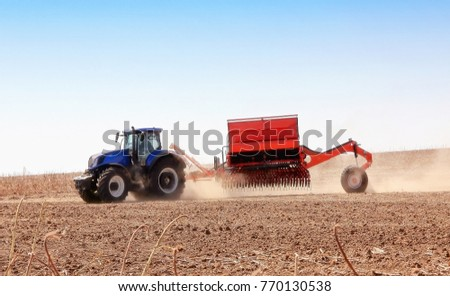 modern combine harvester works in the field. Sowing and harvesting. The concept of agronomy.