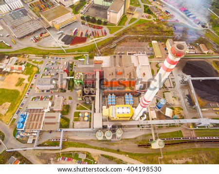 Modern combined heat and power plant from above. Fuming chimney with sulphur removal unit. Aerial view of heavy industry.  - stock photo