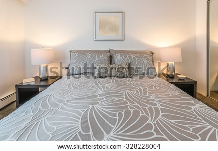 Modern comfortable and elegant luxury master bedroom. Interior design. - stock photo