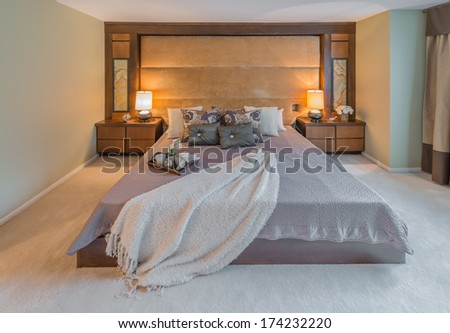 Modern comfortable, cozy, nicely decorated master bedroom. Interior design. - stock photo