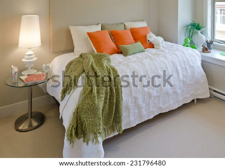 Modern comfortable, nicely decorated bedroom for child with some toys. Interior design. - stock photo