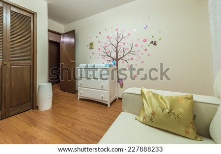 Modern comfortable, nicely decorated children, baby bedroom. Interior design.